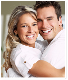 smiling couple in white